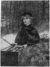 Young woman driving a sleigh